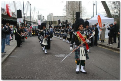 Shree Swaminarayan Gadi Pipe Band Bolton marches down the street