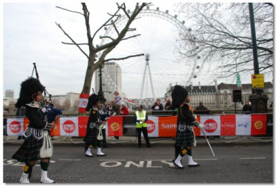 The Band walks past the London Eye