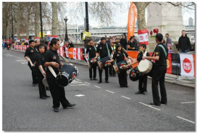 Dhol players play along teh embankment