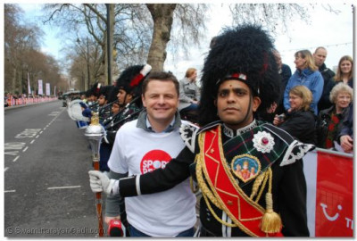 BBC TV presenter, Chris Holins with the Drum Major