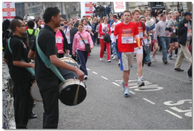 The Band and Dhol players play and the runners begin the race