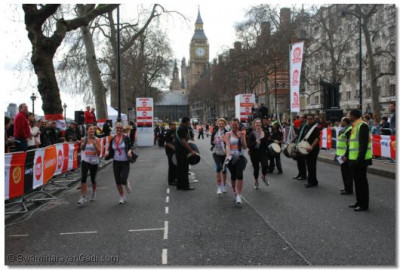 Late comers run past the dhol players
