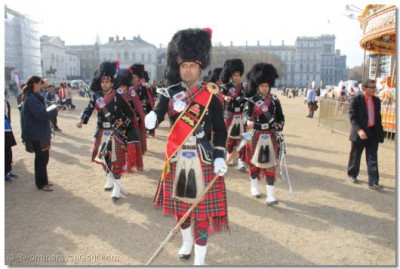 The band marches towards the race starting point at Horse Guards Parade Pall Mall Buckingham Palace
