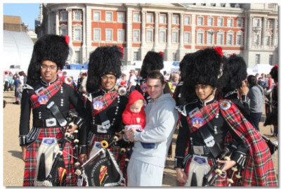 Spectators take the opportunity to take photos with the bandat Horse Guards Parade Pall Mall Buckingham Palace