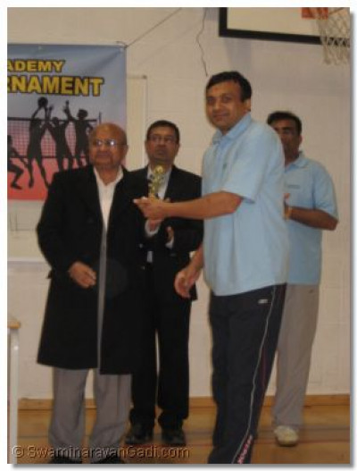 Naran Rabadia - Player of Swamibapa Team B is presented a trophy