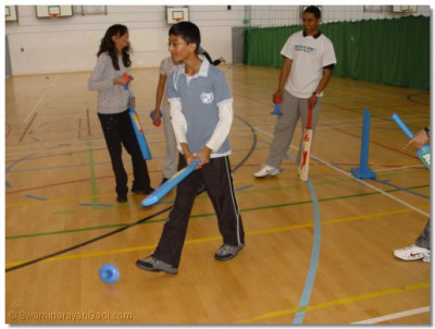Participants take part in the cricket session