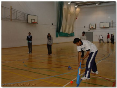 A coach demonstrates some of the skills invovled in batting