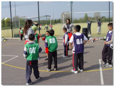 Students try out playing netball