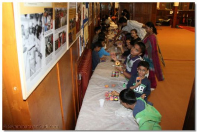Young disciples make diwa's for diwali