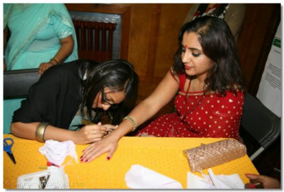 Guests have mehndi put on their hands