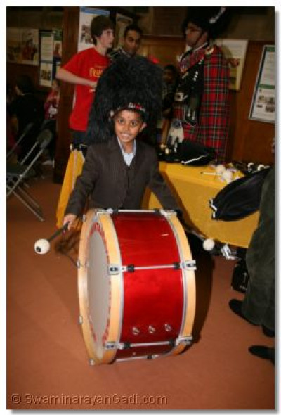 A young enthusiast trys out the drum