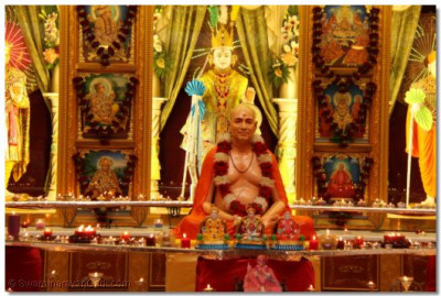 Divine darshan of Jeevanpran Shree Muktajeevan Swamibapa surrounded by lit diva lamps on Diwali at Shree Swaminarayan Temple Golders Green