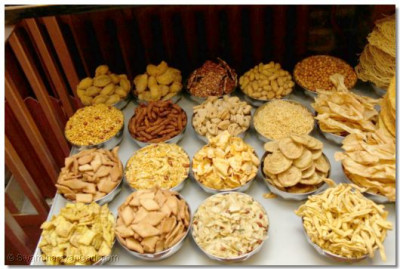 A huge variety of different savoury dishes are arranged in preparation for Annkut