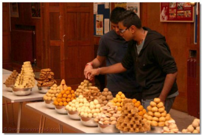 A huge variety of different traditional Indian sweets are arranged in preparation for Annkut