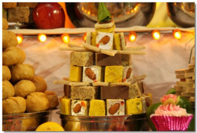 One of the many different sweets presented with a variety of different nuts embedded are offered to Lord Shree Swaminarayanbapa Swamibapa