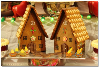 Houses made from skillfully decorated chocalate biscuits and nuts are offered as part of Ankut to please Lord Shree Swaminarayanbapa Swamibapa
