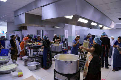 The huge industrial grade kitchen is put to full use as every part of it is utilised in preparing the annakut and prasad items for the Diwali and new year celebrations