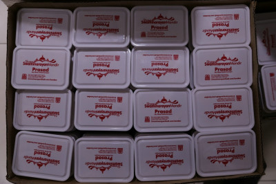 Some of the thousands of prasad boxes packed with sweet and savoury prasad items