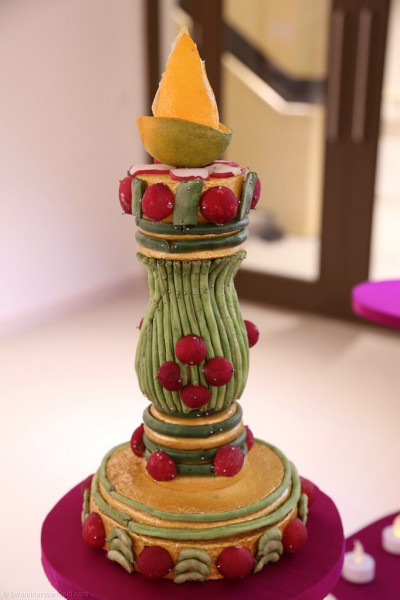 A close up of yet another decorative item made entirely of fruits and vegetables skillfully carved and arranged