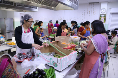 Disciples prepare fruits and vegetables the night before new year