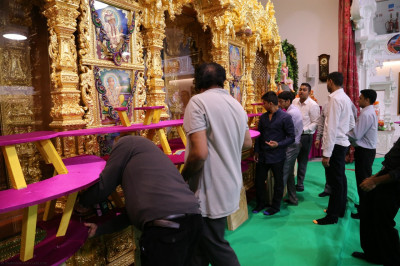 The annakut stands are built from wood and decorated with bright colours and securely placed in front of Lord Shree Swaminarayanbapa Swamibapa