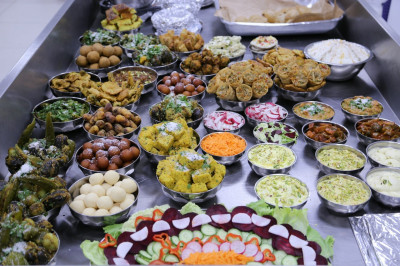 Various 'wet' sweet and savoury items are prepared in the early hours of New Year's day