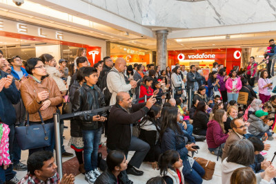 Hundreds of shoppers gather to watch the performances