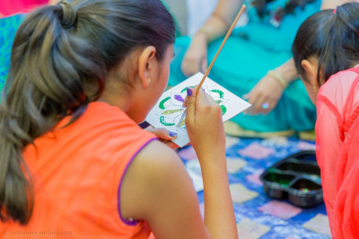 Young children have some fun painting and decorating diwali art