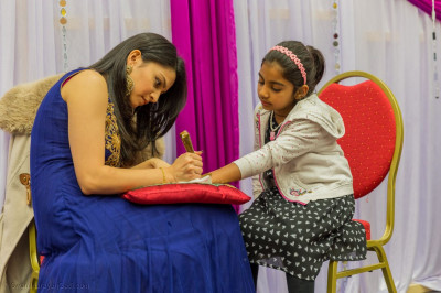Intricate mehendi being applied
