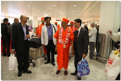 His Divine Holiness Acharya Swamishree together with Sants and disciples arrives at London's Heathrow Airport