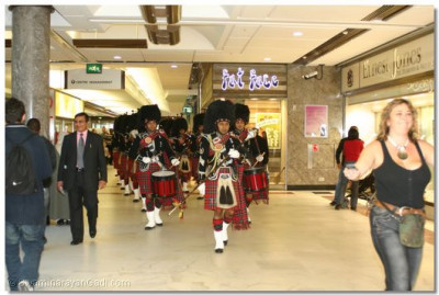 Shree Muktajeevan Pipe Band enters the arena at Brent Cross Shopping Centre in North London