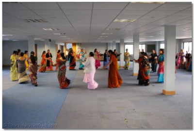 Ladies take part in a raas