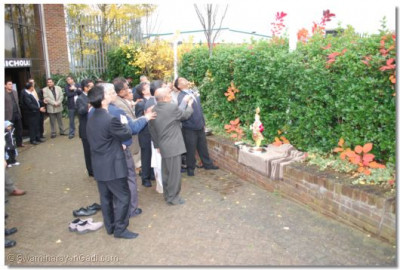 Aarti is performed as the flag flies for the first time at the new site of Shree Swaminarayan Mandir London
