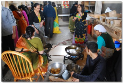 Disciples prepare prasad in one of the warehouses on site