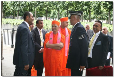 Acharya Swamishree is greeted by disciples outside Palace of Westminster