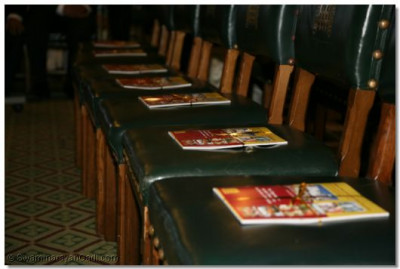 Introduction booklets of Shree Swaminarayan Gadi Sansthan placed on the chairs for guests