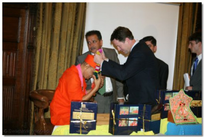 Leader of the Liberal Democrats Nick Clegg garlands Acharya Swamishree