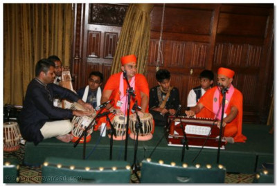 Sants and disciples perform a classical Indian piece