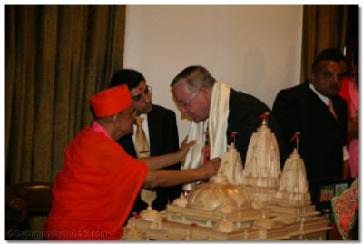 Mr Martin Russell, Queens Deputy Lieutenant for North London, is honoured by Achayra Swamishree