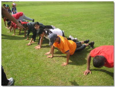 Participants line up for press-ups