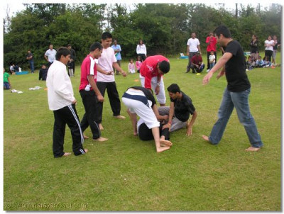 The defending team bring down the attacker playing kabadi