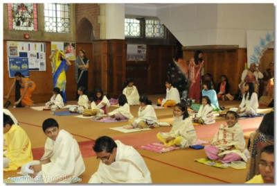 Young disciples wait to the pooja workshop to commence