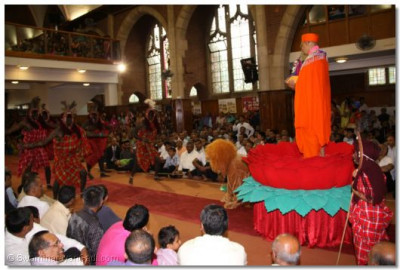 Masai warriors perform the goma dance in front of Acharya Swamishree