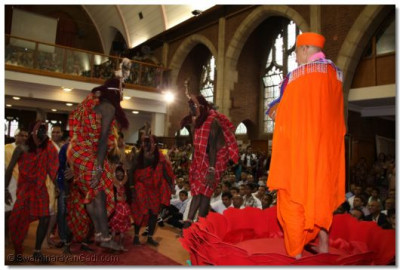 Masai warriors dance to the pipe music