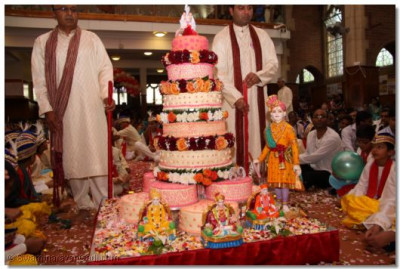 Acharya Swamishree's 69th Birthday cake is bought during the Swagat