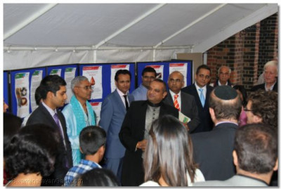 Shree Prem Patel welcomes and introduces guests to the Sewa Day Exhibition