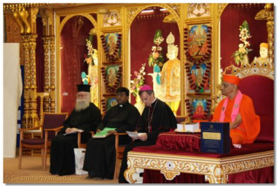 Revd Deacon Meliton, Emissary of The Archbishop of the Diocese of Westminster Bishop Arnold, Revd Khan and Acharya Swamishree seated on stage