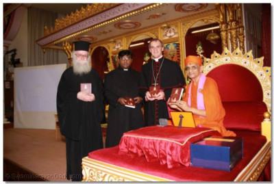 Revd Deacon Meliton, Revd Khan, Bishop Arnold, and Acharya Swamishree and inaugurate the scripture Sadachar Sandesh