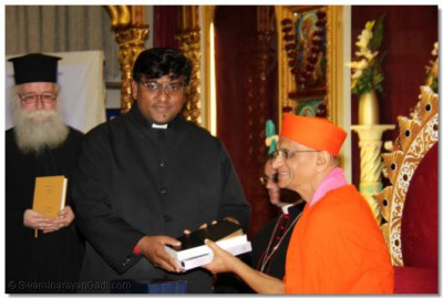Emissary of The Archbishop Canterbury Revd Khan presents the King John Holy Bible to Acharya Swamishree