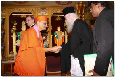 Acharya Swamishree welcomes and greets Revd Deacon Meliton Emmisary of the Archbishop Gregorios of Thyateira and Great Britain